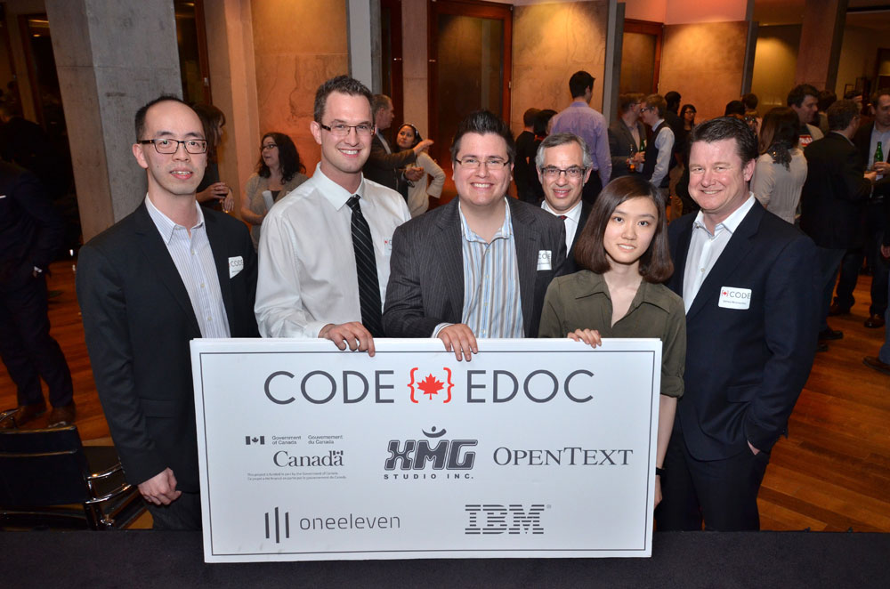 CODE winning teams with judges Treasury Board President Tony Clement and James McGourlay, Senior VP, Global Customer Service, OpenText at the CODE Grand Finale